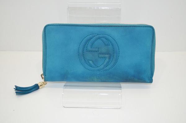 グッチの財布のクリーニング前・全体的に色が剥離している画像