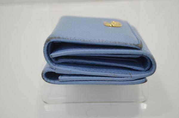 グッチのプチマーモントの財布のクリーニング前の側面画像
