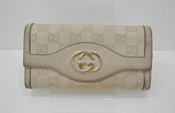 グッチ(スーキー・シマ)の財布のクリーニング前の画像